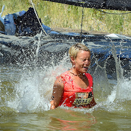 Oups ! by Marco Bertamé - Sports & Fitness Other Sports ( water, red, splash, améville, fall, drops, lady, number, the mud day, athlete )