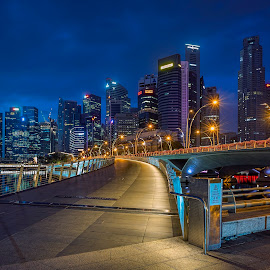 by Gordon Koh - City,  Street & Park  Night ( clouds, shenton way, skyline, cityscape, travel, singapore, city, fullerton, blue hour riverfront, financial district, skyscraper, asia, buildings, jubliee bridge, long exposure, waterfront )
