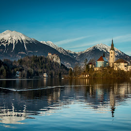 by Mario Horvat - Buildings & Architecture Public & Historical ( water, reflection, mountains, church, sunset, bled, lake, landscape )