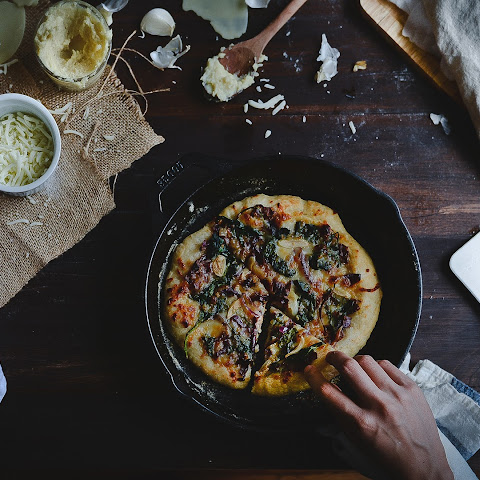 Spinach, Caramelized Onion & Roasted Garlic White Pizza.