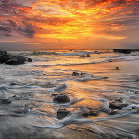 Sun Burn by Agoes Antara - Landscapes Sunsets & Sunrises ( nature, waterscape, wave, stone, cloud, pwcsunbeams-dq, beach, landscape )