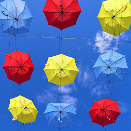 The colorful umbrellas and a blue sky by Svetlana Saenkova - Artistic Objects Other Objects ( red, blue, yellow, umbrellas, rows, colorful, summer,  )