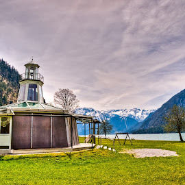 Mountains Lighthouse by Eduard Andrica - Buildings & Architecture Other Exteriors ( clouds, water, building, europe, green, white, lighthouse, lake, travel, landscape, mountains, sky, nature, achensee, snow, austria, alps )
