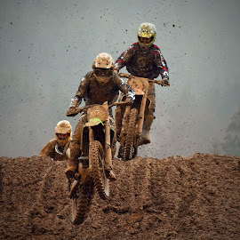 Jump Into The Mud by Marco Bertamé - Sports & Fitness Motorsports ( mud, bike, motocross, clumps, motorcycle, trio, race, competition, jump,  )