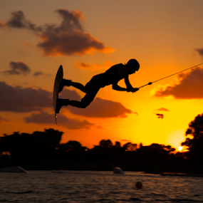 Surfers at sunset by Yuval Shlomo - Sports & Fitness Surfing