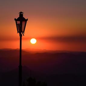 Sunset over San Marino by Lucian Satmarean - Landscapes Sunsets & Sunrises ( hills, sunset, lamp, italy, light )