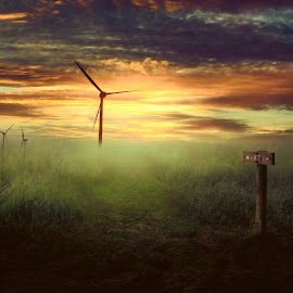 Still in the wind by Dominic Wade - Digital Art Places ( clouds, wind turbine, photo manipulation, sunrise, landscape, skies, fields )