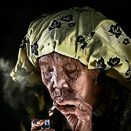 my lighter by Mohd Helmie Wahab - People Portraits of Women ( senior citizen )