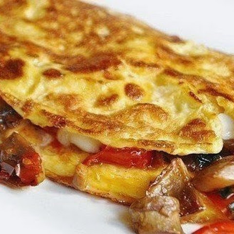 Omelette With Mushrooms, Tomatoes And Cheese