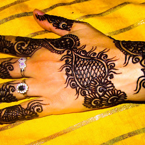 Bride getting ready by Aamir Soomro - Wedding Getting Ready ( fashion, getting ready, right hand, yellow, bride hand, tatoo, henna, hand, mehndi, mehndi design, fresh, dark, rings, design )