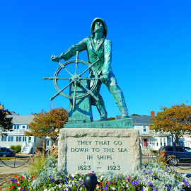 Fisherman's Memorial by Kristine Nicholas - Novices Only Objects & Still Life ( old, memorial, wheel, vintage, brick, ship, boats, stone, massachusetts, boat, fishing boat, concrete, hat, captain, fence, fishermen, statue, gloucester, ma, ships, fishing, flowers, fisherman, antique, man, flower )