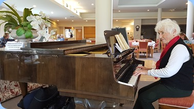 Audrey Henden playing the Schimmel grand piano.