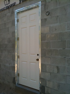Custom home building tips what s a man door and do i for Custom home building tips