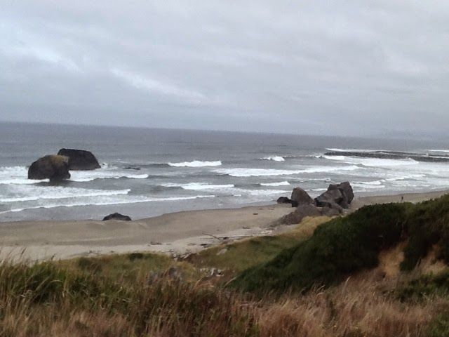A beach in Bandon, America, on an overcast day.