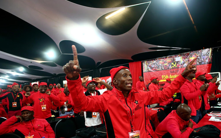 SACP delegates sing during the 14th Congress of SACP held at Birchwood Hotel. Picture: MASI LOSI