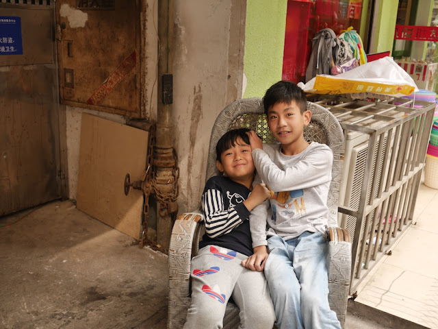 two boys sitting on a chair in Changsha, Hunan
