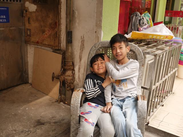two boys sitting on a chair in Changsha, Hunan
