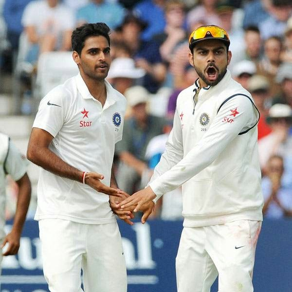 India's Bhuvneshwar Kumar, left, is congratulated by Virat Kohli after bowling England's Matt Prior caught M. S. Dhoni for 5 runs during day three of the first Test between England and India at Trent Bridge cricket ground, Nottingham, England, Friday, July 11, 2014.