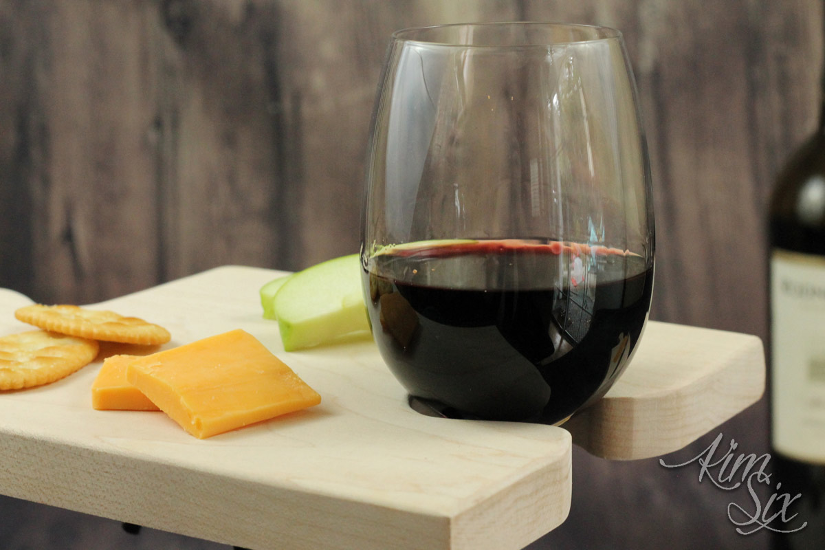 Notch in cutting board to hold wine glass