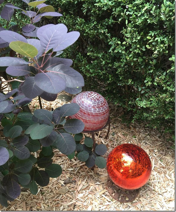 red gazing balls with smoke plant