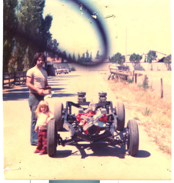 Here is the chassis of my 39 Ford. The tall one is me, the little girl is my oldest daughter Katrina. This was taken in 1978.