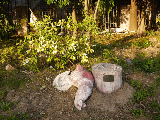 knocked-over rooster statue at at Fenghuangzhou Park in Chaozhou