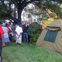 Crowd gathers to be tested for HIV/AIDS in the two tents