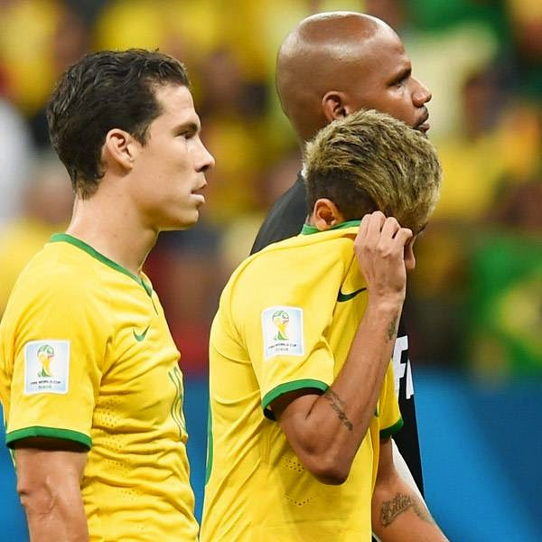 Brazil's midfielder Hernanes, Brazil's injured forward Neymar and Brazil's goalkeeper Jefferson react at the end of the third place play-off football match between Brazil and Netherlands during the 2014 FIFA World Cup at the National Stadium in Brasilia on July 12, 2014.
