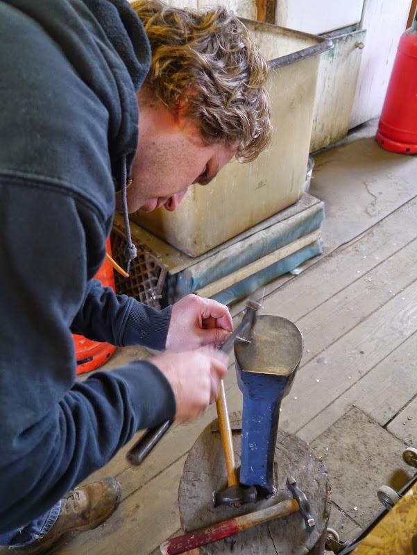 Matt makes a start on hammering out the bar of gold