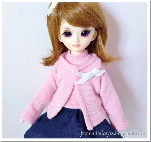 Follow the tutorial link to make a cute matching sock sweater to complete the doll sweater set.