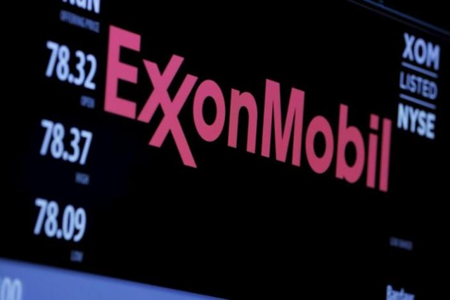 The logo of Exxon Mobil Corporation is shown on a monitor above the floor of the New York Stock Exchange in New York, New York, U.S. 30 December 2015. Photo: Lucas Jackson / REUTERS