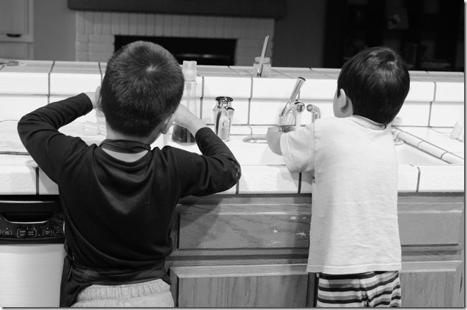 Boys doing dishes
