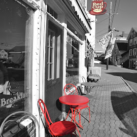 Red Chairs  by Lorraine D.  Heaney - City,  Street & Park  Street Scenes