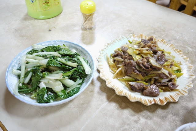 vegetables dish next to a dish with donkey meat