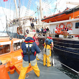 21 August 2011 - Training with the Jubilee Sailing Trust's ship Tenacious - getting ready to pass back a stretcher with our casualty 'dummy' strapped inside. Photo: RNLI Poole/Rob Inett