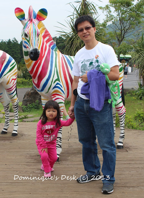 R and Tiger girl posing infront of some colorful zebras