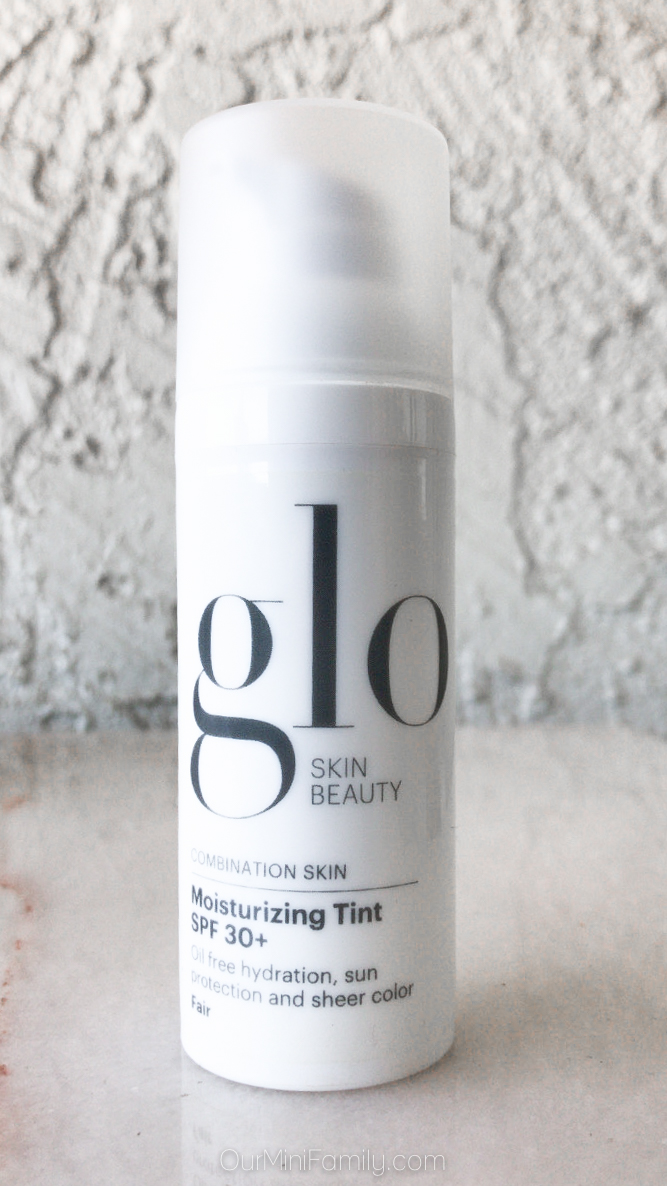 Glo Skin Beauty Tinted Moisturizer with SPF 30 plus on white marble