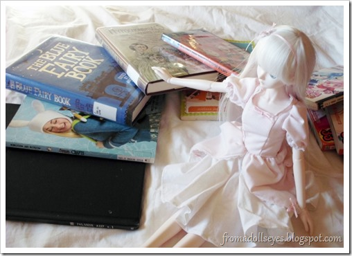 Ball Jointed Doll Showing Off Some Library Books