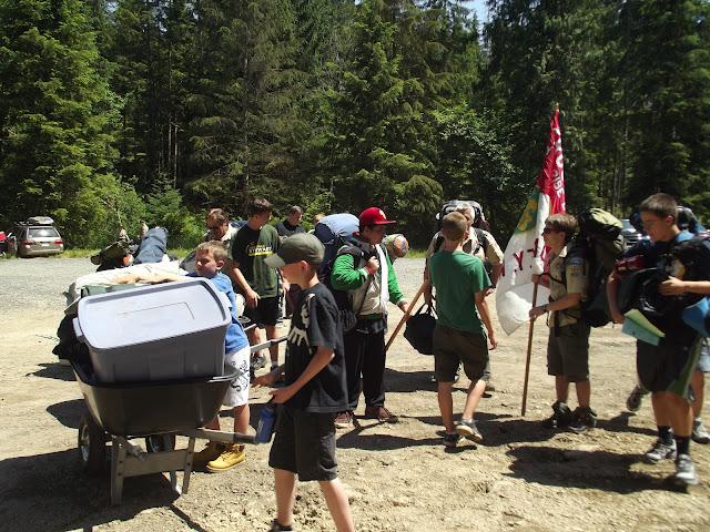 Loading up wheelbarrows with troop gear