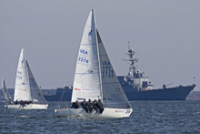 J/24 one-design sailboats- so illegally supersonically fast, needs military escort!