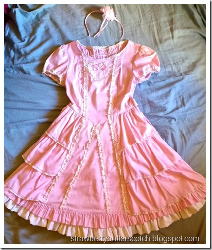 The after photo of the madeover and improved pink dress, so much cuter now.