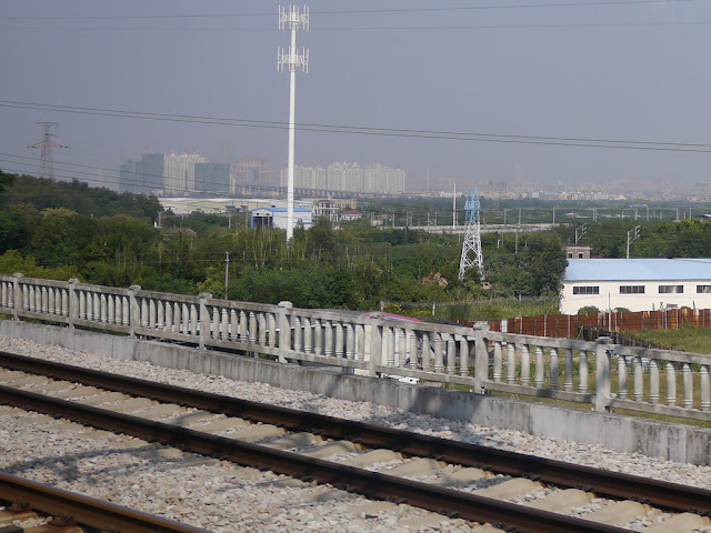 Far away view of the Guangzhou Circle from a passing high-speed train