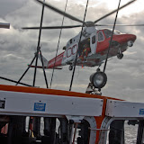 9 October 2011. Helicopter 106 winchman prepares to winch onto Poole lifeboat during exercise. Photo: Poole RNLI/Ade