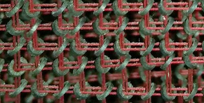 Detail of the core memory in the IBM 1401. Each toroidal ferrite core stores one bit.
