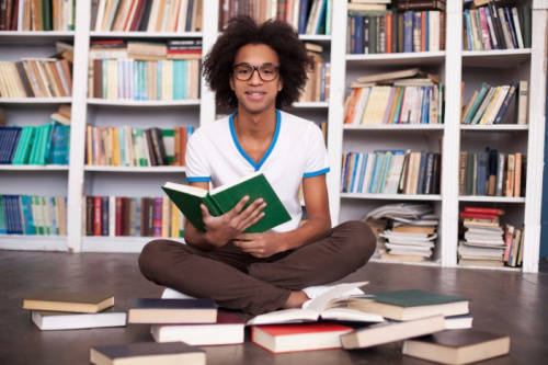 high schooler in a home library