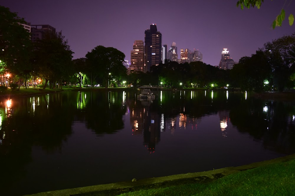 After the Mexican feast, bloated and beyond stuffed, we take a refreshing night-time stroll in Lumphini Park.  Here we are hanging out by the lake and enjoying the reflections of the surrounding skyscrapers.