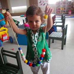 Pre Nursery Threading the beads-June-July