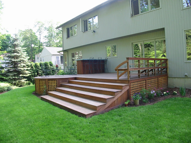 Comfortable steps that are for seating, plant containers and access.