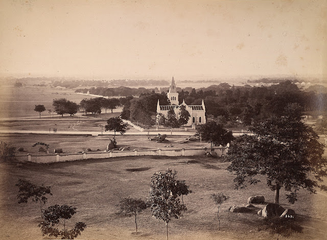 Photograph showing the Scotch Kirk and cemetery, with the cantonment parade ground and race course beyond, at Secunderabad (now in Andhra Pradesh) taken by Lala Deen Dayal, c. 1890. Secunderabad is situated in Andhra Pradesh next to Hyderabad, its older twin city (founded c. 1590). The Nizam of Hyderabad, Sikander Jah, entered into a subsidiary alliance with the British East India Company in 1798, involving military and political cooperation. Under the alliance an area north of Hussain Sagar lake was to be made a cantonment. Soon after the alliance was signed 5,000 British troops arrived and camped north of Hyderabad; the cantonment was laid out in 1806 and named after the Nizam, and thus was Secunderabad founded. Initially it encompassed an area of four square miles and had a population of 5,000 troops plus several thousand civilians, however 60 years later it had increased to 17 square miles and the population, including the armed forces was 50,000. The town continued to develop as i