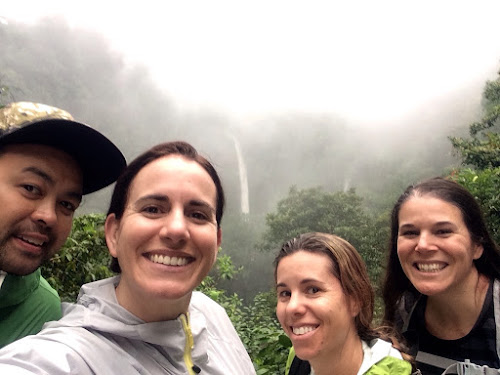 Four people and a waterfall